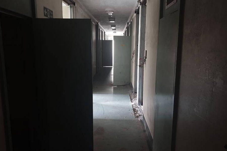 Ashwell Prison. Dark haunted corridor, spooky hallway