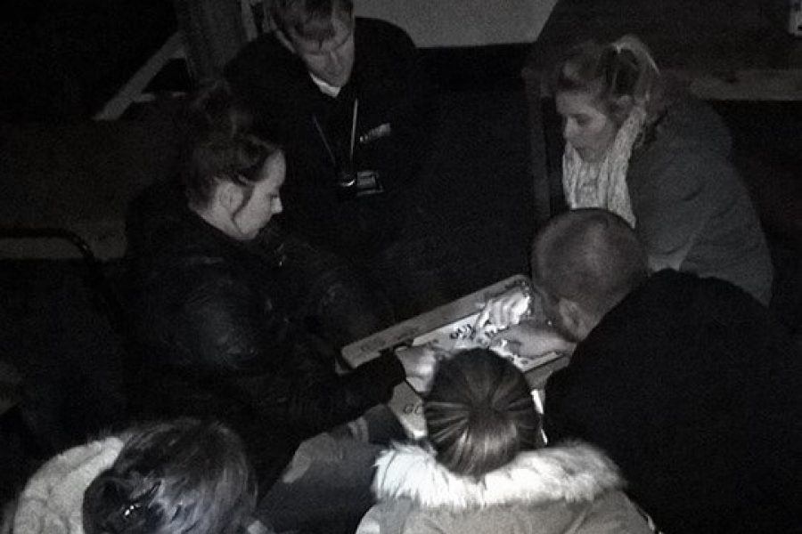 Low Cost Great Value Ghosy Hunt Events | Haunted House Ghost Huntinggroup of people using ouija board