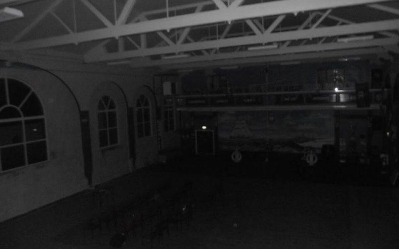 dimly lit barracks room