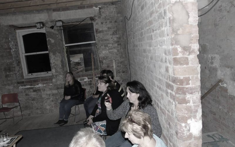 Group of people in an empty room