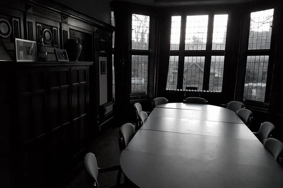 Old Haunted School room with large table surrounded by chairs