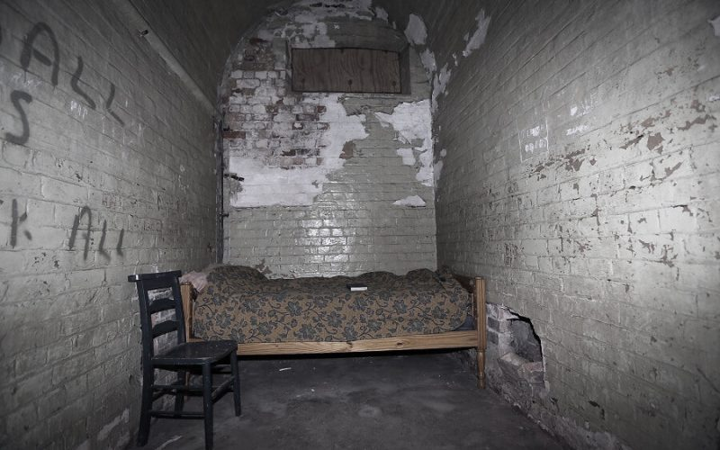 Old Nick Theatre bed in a rundown room