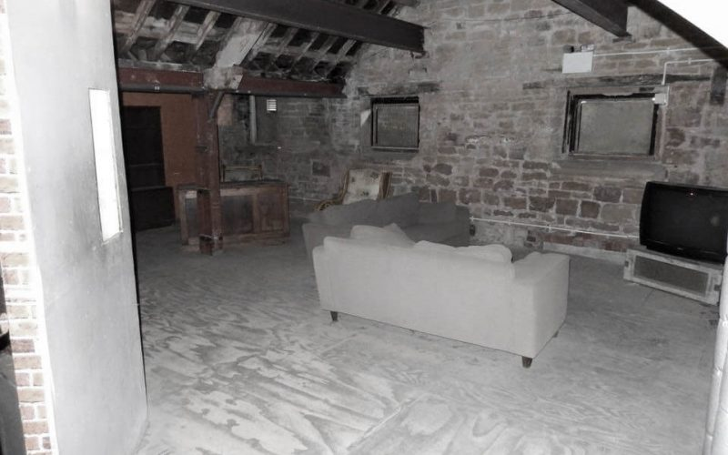 The Village sofas and tv